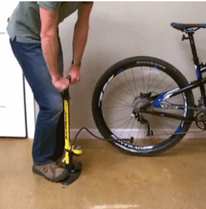 airing up a bike tire with floor pump