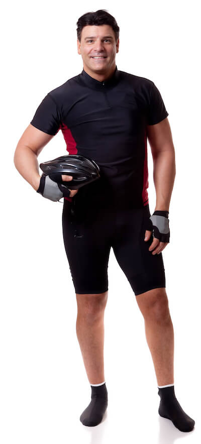 man in black cycling suit holding helmet