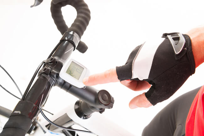 cyclist demonstrates checking mileage
