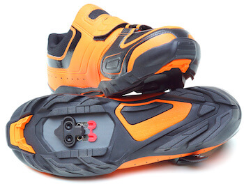 orange cycling shoe with spd cleats installed