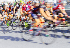 blur of cyclists racing