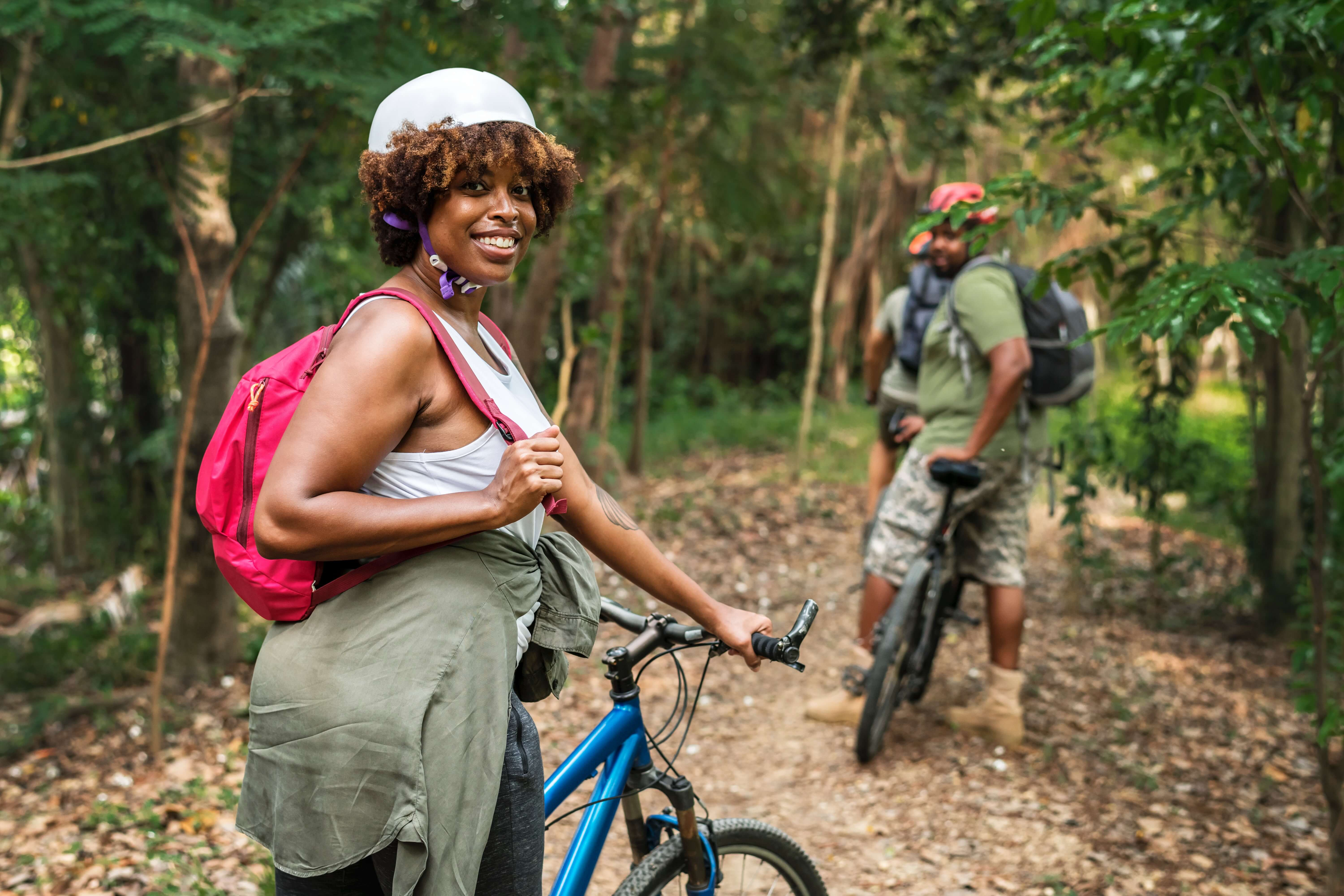 Active adults biking through the woods