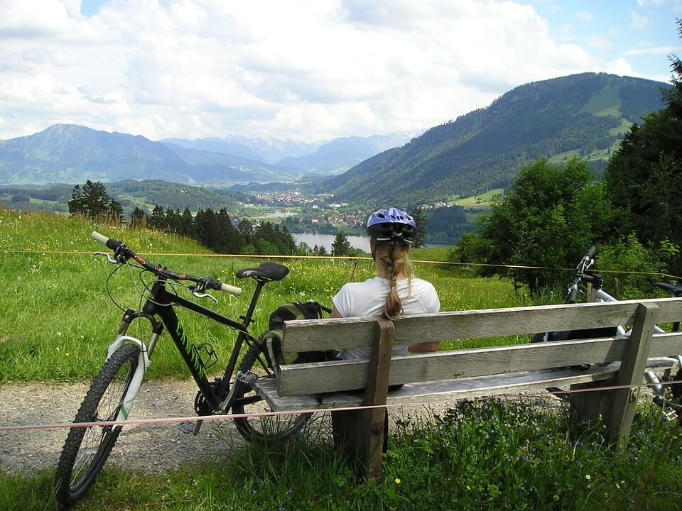 woman on a bench with a bike