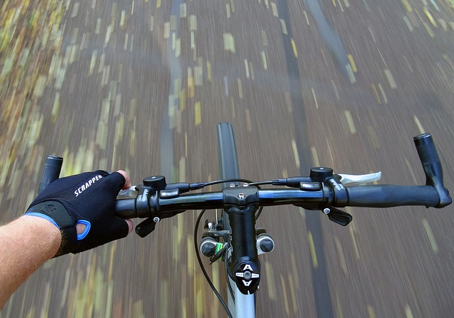 photo focused on handlebar of a bicycle while it is running