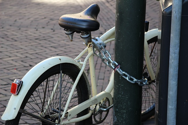 bike locked and parked in a street