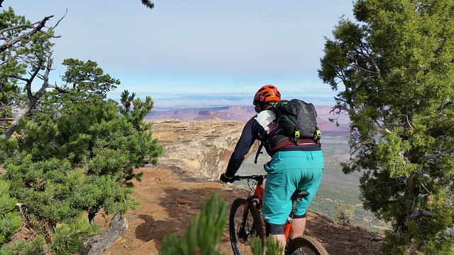 a cyclist riding a bike across one of the mountain bike trails in Moab, Utah