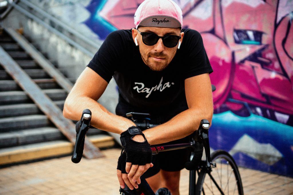 a cyclist wearing gloves, sunglasses and other cycling accessories