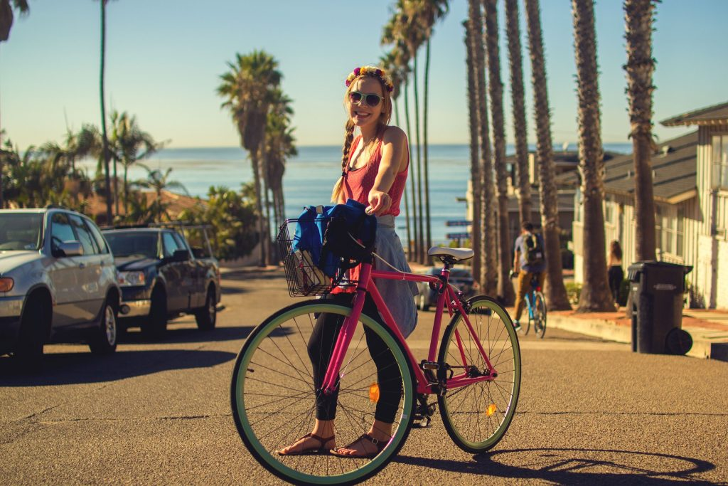 Smiling woman wearing a sunglasses is using the best women's road bikes for beginners